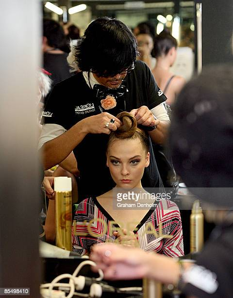 A model has her hair styled backstage ahead of the L'Oreal Paris Runway 6 presented by Cosmopolitan during L'Oreal Melbourne Fashion Festival 2009 at...