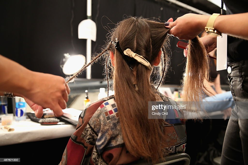 A model has her hair styled backstage at the Desigual fashion show during Spring 2016 New York Fashion Week: The Shows at The Arc, Skylight at Moynihan Station on September 10, 2015 in New York City.