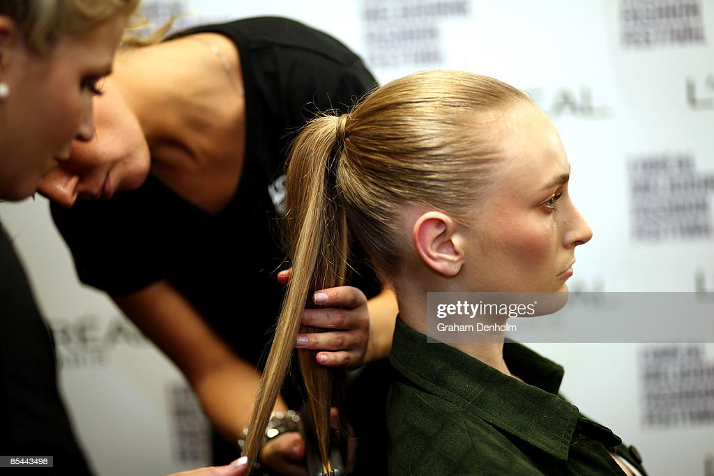 A model has her hair styled backstage during the L'Oreal Melbourne Fashion Festival 2009 at the Malvern Town Hall/Peninsula Docklands on March 16, 2009 in Melbourne, Australia.