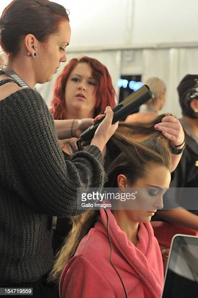 A model has her hair styled backstage during the MercedesBenz Fashion Week Africa 2012 held at Melrose Arch on October 24 2012 in Johannesburg South...