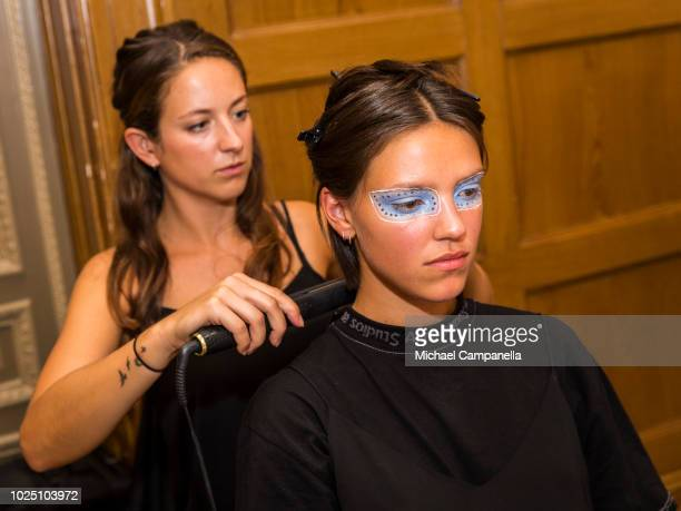 Model has her hair styled backstage on the second day of Fashion Week Stockholm at the Grand Hotel on August 29, 2018 in Stockholm, Sweden.