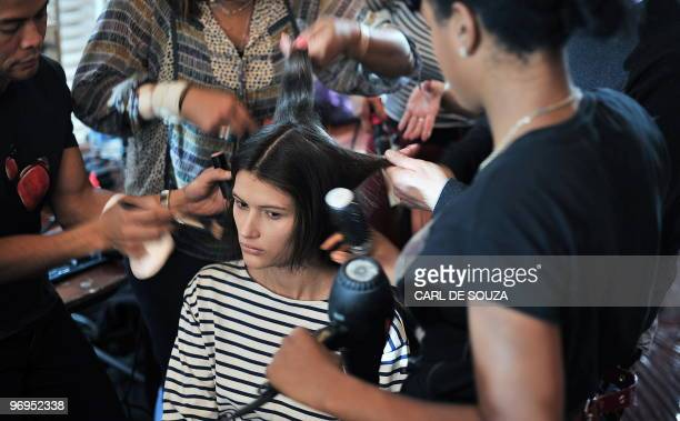 A model has her make up applied backstage before a show by fashion designer Nicole Farhi at the Royal Opera House London during the fifth day of...