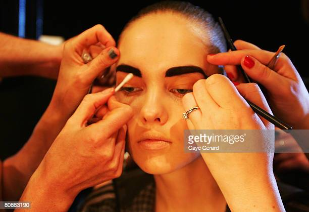 Model has her make-up applied backstage ahead of the Kirrily Johnston show on the first day of the Rosemount Australian Fashion Week Spring/Summer...