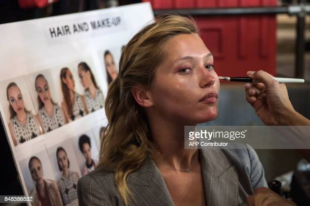 A model has make up applied backstage before the start of the Topshop catwalk show for the Spring/Summer 2018 collection on the third day of The...