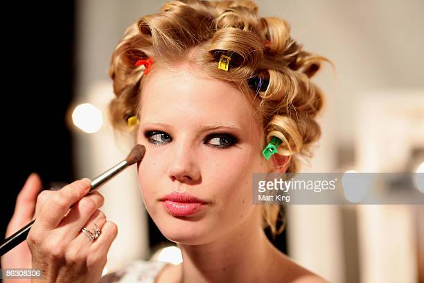 Model has make-up applied backstage ahead of the V Australia New Generation catwalk show at the Overseas Passenger Terminal, Circular Quay on day...