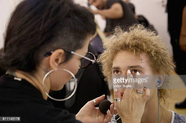 A model has makeup applied backstage during FENTY x PUMA by Rihanna at Hotel Salomon de Rothschild on September 28 2016 in Paris France