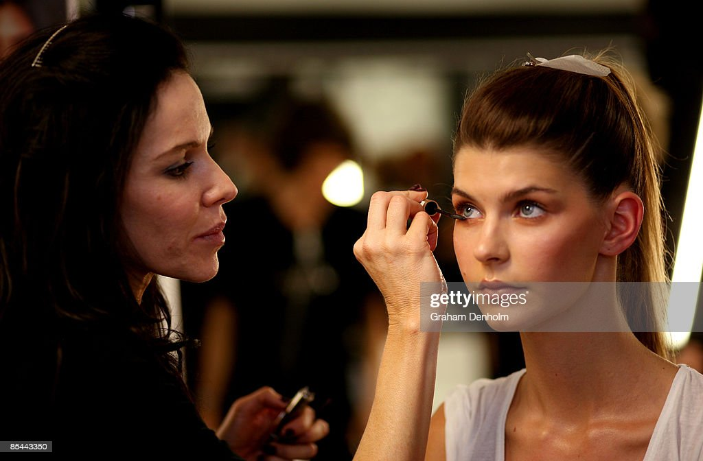 A model has makeup applied backstage during the L'Oreal Melbourne Fashion Festival 2009 at the Malvern Town Hall/Peninsula Docklands on March 16, 2009 in Melbourne, Australia.
