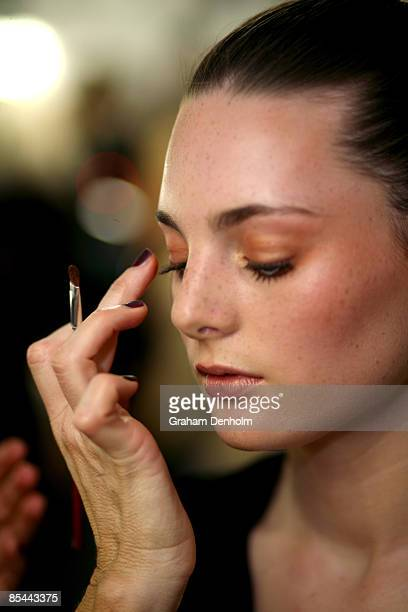 A model has makeup applied backstage during the L'Oreal Melbourne Fashion Festival 2009 at the Malvern Town Hall/Peninsula Docklands on March 16 2009...