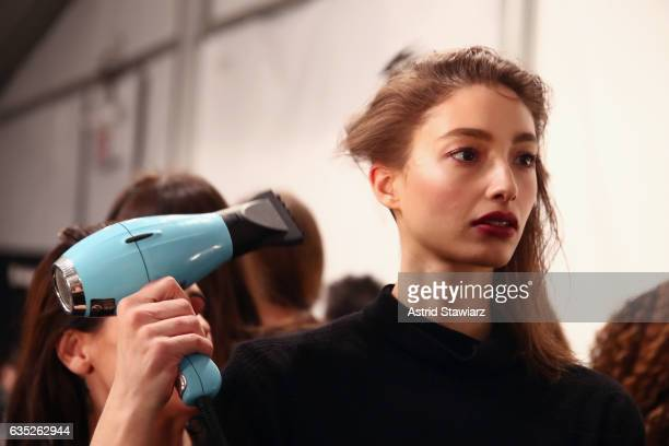 A model has their hair done backstage for the Badgley Mischka collection during New York Fashion Week The Shows at Gallery 1 Skylight Clarkson Sq on...