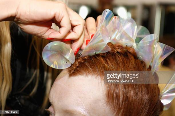 A model has their hair styled backstage ahead of the Phoebe English show during London Fashion Week Men's June 2018 at BFC Show Space on June 10 2018...