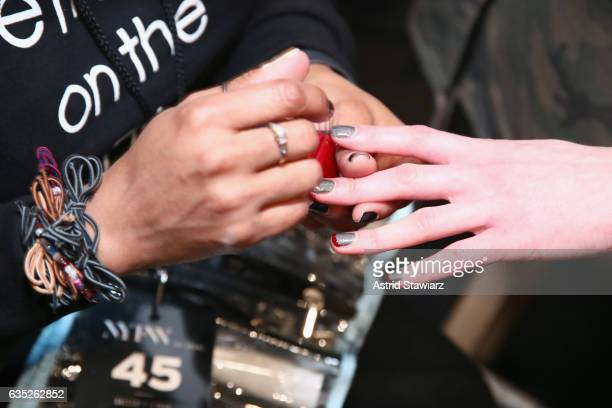 A model has their nails done backstage for the Badgley Mischka collection during New York Fashion Week The Shows at Gallery 1 Skylight Clarkson Sq on...
