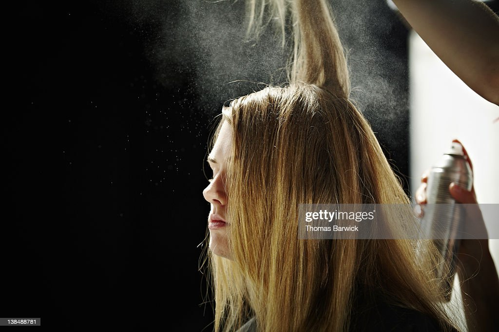 Model having hair done backstage at fashion show : Stock Photo