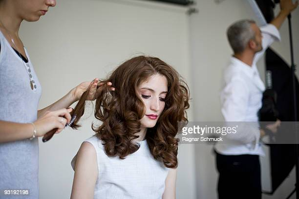 a model having her hair prepared - behind the scenes stock pictures, royalty-free photos & images