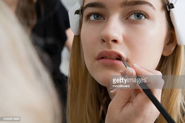 model having makeup applied - modeshow stockfoto's en -beelden