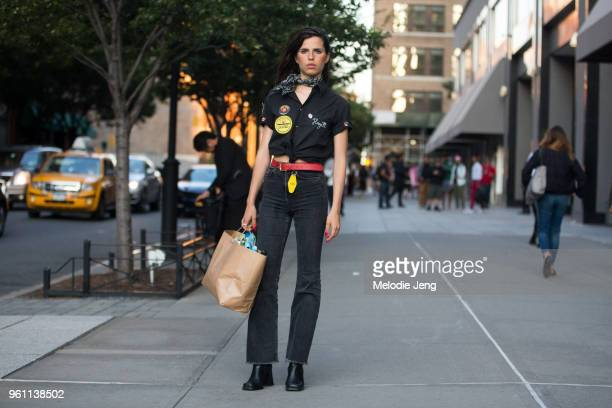 Model Hayett McCarthy wears a black bandana around her neck, a vintage-style bowling t-shirt with her name on it, a red belt and black jeans during...