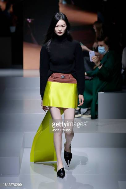 Model He Cong walks the runway at the Prada Womenswear Spring / Summer 2022 fashion show in Milan during the Milan Fashion Week - Spring / Summer...