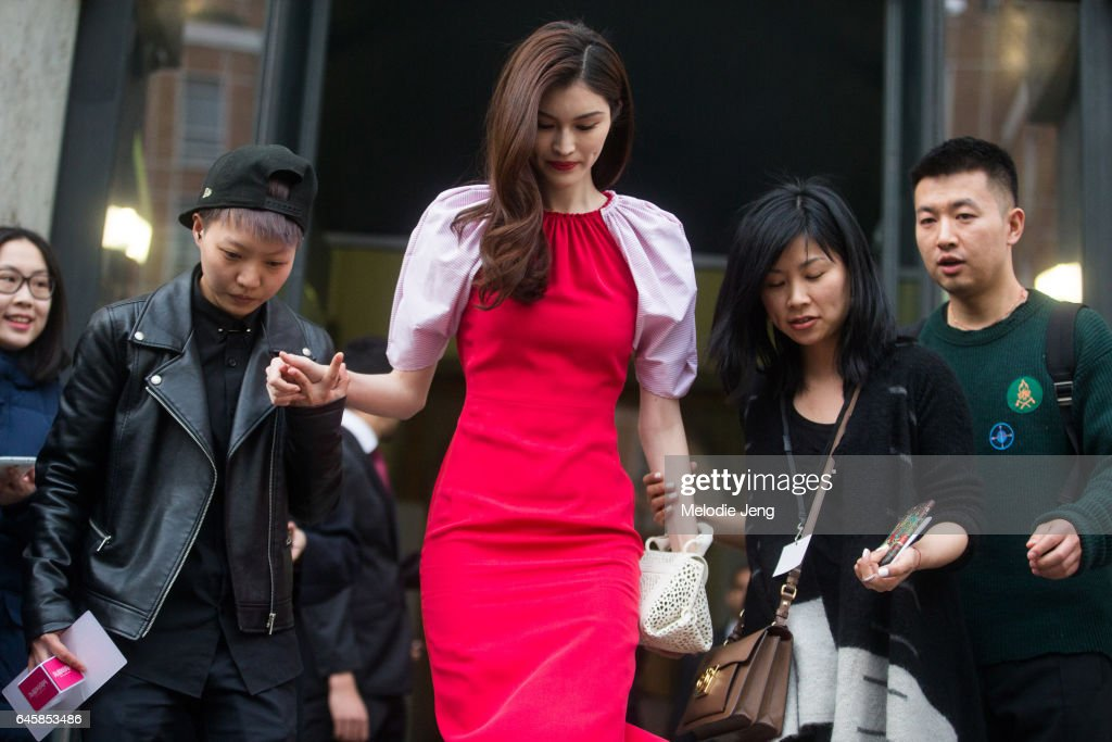 Model He Sui wears a pink and red dress after attending Ferragamo during Milan Fashion Week Fall/Winter 2017/18 on February 26, 2017 in Milan, Italy.