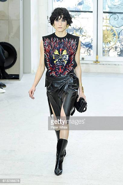 Model Heather Kemesky walks the runway during the Louis Vuitton show as part of the Paris Fashion Week Womenswear Spring/Summer 2017 on October 5...