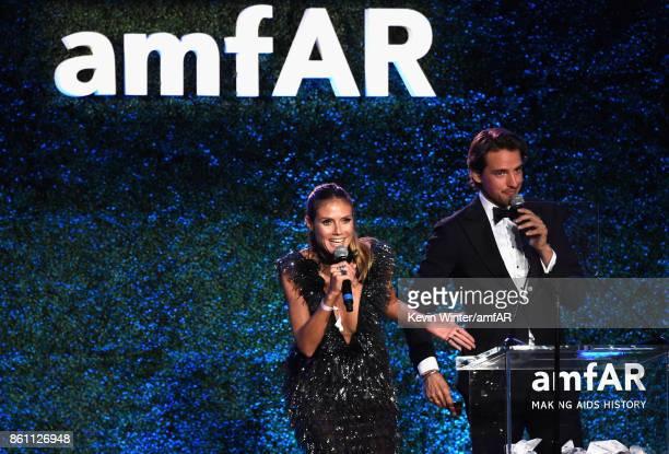 Model Heidi Klum Alexander Gilkes speak onstage at the amfAR Gala Los Angeles 2017 at Ron Burkle's Green Acres Estate on October 13 2017 in Beverly...