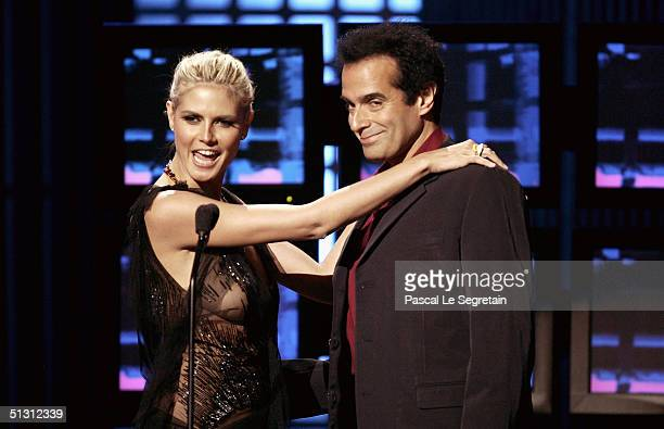 Model Heidi Klum and magician David Copperfield are seen on stage during the 2004 World Music Awards at the Thomas and Mack Center on September 15...