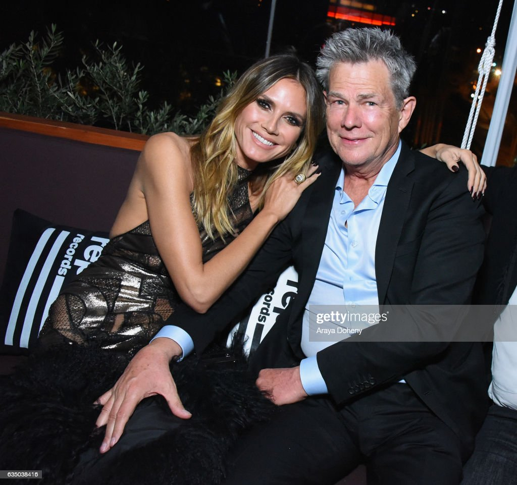 Model Heidi Klum (L) and musician David Foster at a celebration of music with Republic Records, in partnership with Absolut and Pryma, at Catch LA on February 12, 2017 in West Hollywood, California.