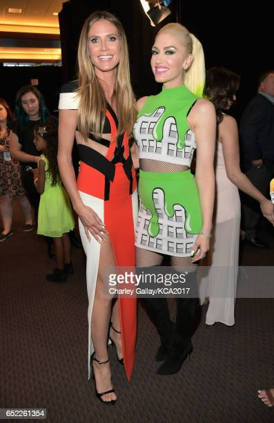 Model Heidi Klum and Singer Gwen Stefani in the green room at Nickelodeon's 2017 Kids' Choice Awards at USC Galen Center on March 11 2017 in Los...