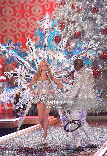 Model Heidi Klum and singer Seal onstage wearing Swarovski embellished garments by Victoria's Secret at the 12th Victoria's Secret Fashion show at...
