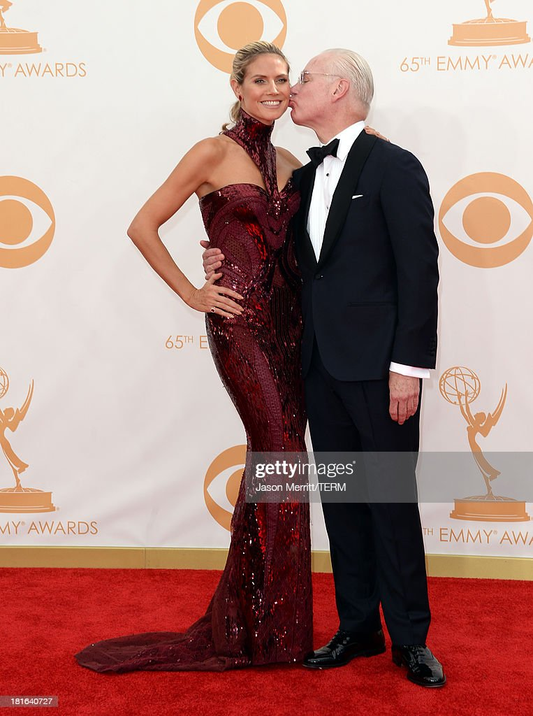 Model Heidi Klum and Tim Gunn arrive at the 65th Annual Primetime Emmy Awards held at Nokia Theatre L.A. Live on September 22, 2013 in Los Angeles, California.