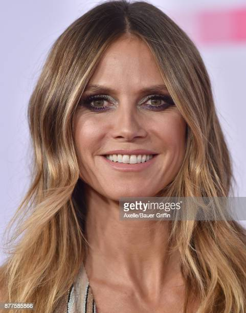 Model Heidi Klum arrives at the 2017 American Music Awards at Microsoft Theater on November 19 2017 in Los Angeles California