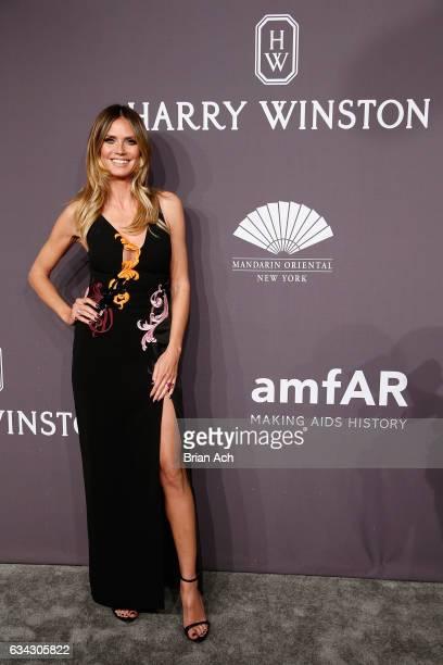 Model Heidi Klum attends the amfAR New York Gala where Harry Winston is a Presenting Sponsor at Cipriani Wall Street on February 8 2017 in New York...