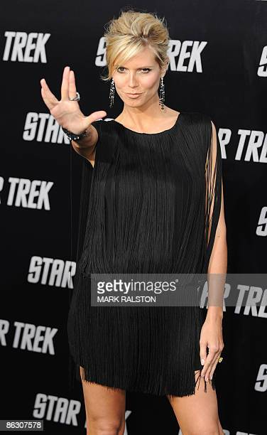 """Model Heidi Klum flashes a """"Star Trek"""" salute as she arrives at Grauman's Chinese Theatre in Hollywood for the premiere of the movie """"Star Trek"""" in..."""