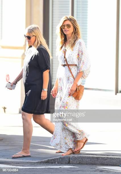 Model Heidi Klum is seen walking in soho on June 29, 2018 in New York City.