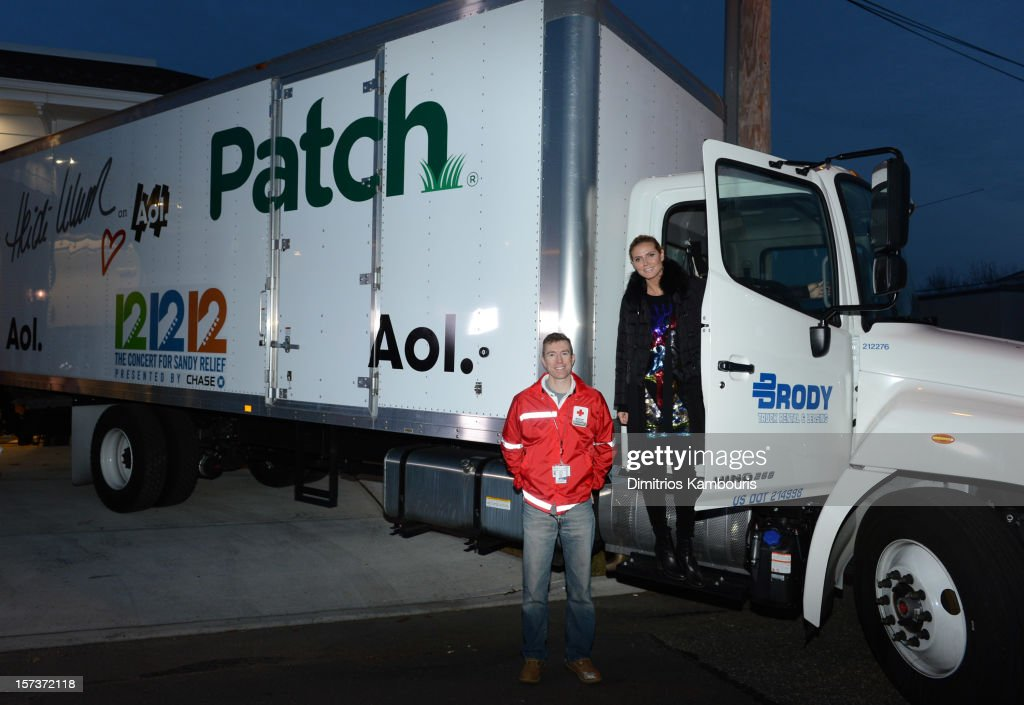Model Heidi Klum is seen with American Red Cross CEO Josh Lockwood as she teams up with friends at AOL, Patch and The American Red Cross to benefit Hurricane Sandy relief efforts at American Red Cross and Patch Sites on December 2, 2012 in Seaford, New York.