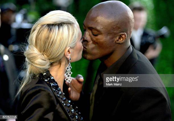 Model Heidi Klum kisses fiance musician Seal as they arrive at the Vanity Fair Oscar Party at Mortons on February 27 2005 in West Hollywood California