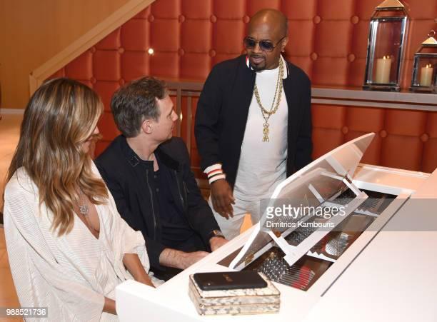 Model Heidi Klum Niche Media and DuJour Media Jason Binn and composer recording artist Jermaine Dupri attend a dinner at American Cut at Ocean Resort...