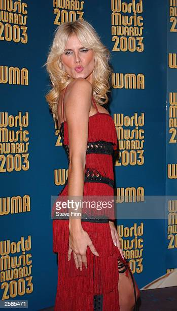 """Model Heidi Klum poses backstage at the """"2003 World Music Awards"""" at the Monte Carlo Sporting Club on October 12, 2003 in Monaco."""