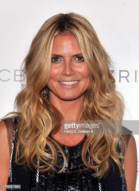 Model Heidi Klum poses backstage at the BCBGMAXAZRIA show during Spring 2014 Mercedes-Benz Fashion Week at The Theatre at Lincoln Center on September...