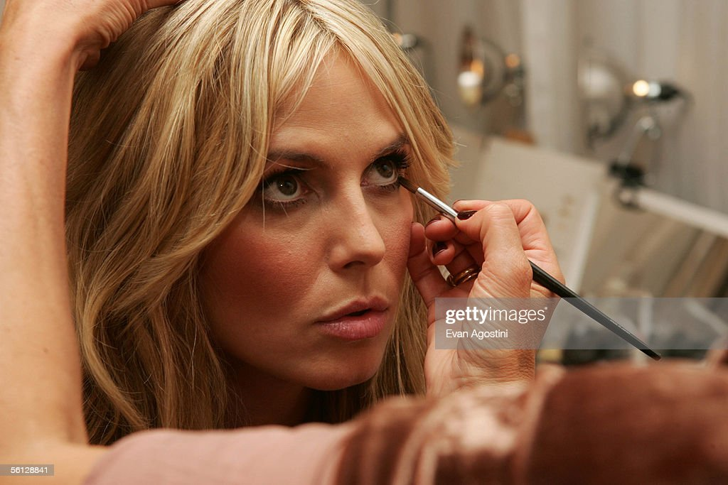 Model Heidi Klum prepares backstage for The Victoria's Secret Fashion Show at the 69th Regiment Armory November 9, 2005 in New York City.