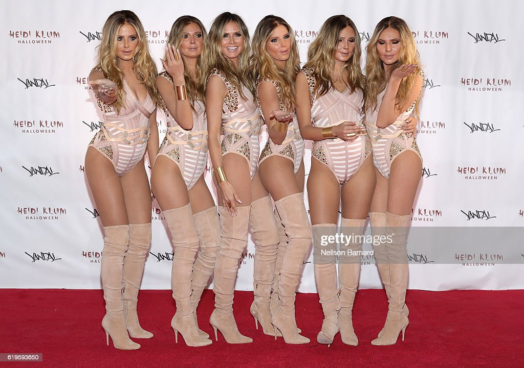Model Heidi Klum (3rd L) reveals her costume during Heidi Klum's 17th Annual Halloween Party sponsored by SVEDKA Vodka at Vandal on October 31, 2016 in New York City.
