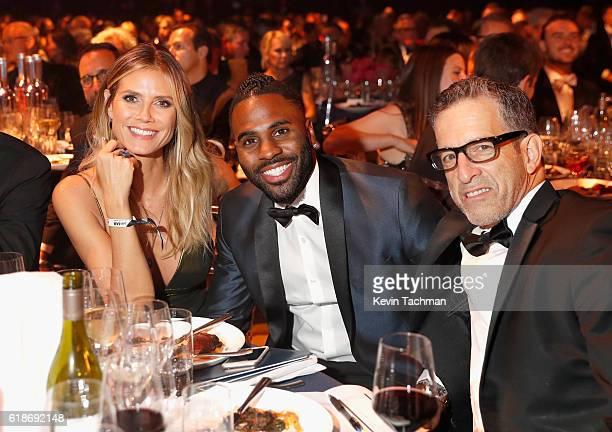 Model Heidi Klum singer Jason Derulo and designer Kenneth Cole attend amfAR's Inspiration Gala at Milk Studios on October 27 2016 in Hollywood...