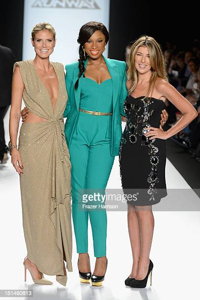 Model Heidi Klum singer Jennifer Hudson and Nina Garcia walk the runway at the Project Runway Spring 2013 fashion show during MercedesBenz Fashion...