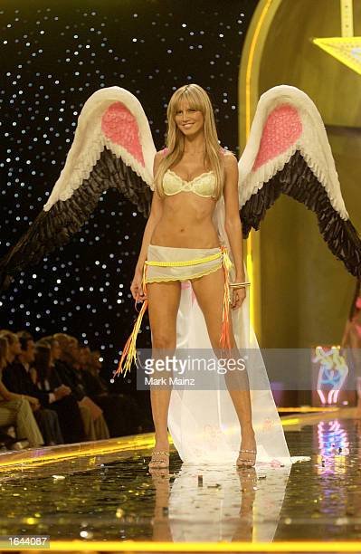 Model Heidi Klum walks the runway at the Victoria Secret Fashion Show at the Lexington Avenue Armory November 14 2002 in New York City New York