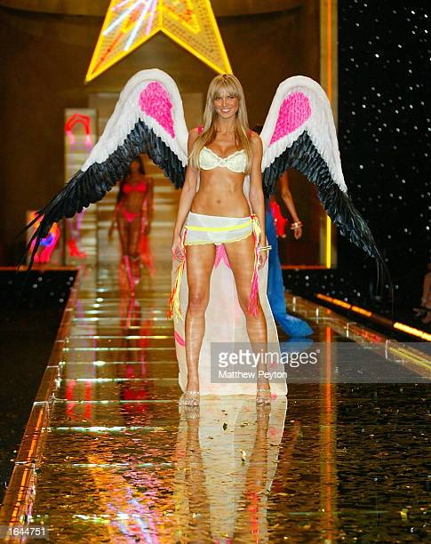 Model Heidi Klum wears an outfit during the Victoria Secret Fashion Show at the Lexington Avenue Armory November 14 2002 in New York City