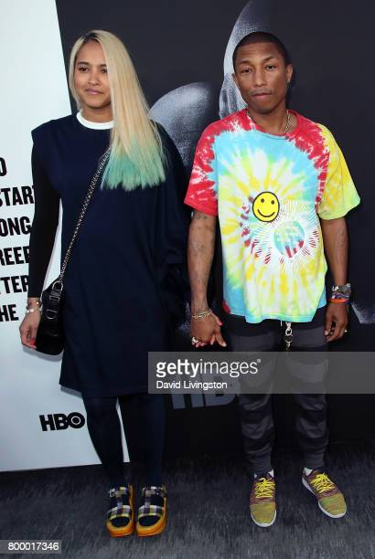 Model Helen Lasichanh and husband singer/songwriter Pharrell Williams attend the premiere of HBO's 'The Defiant Ones' at the Paramount Theatre on...