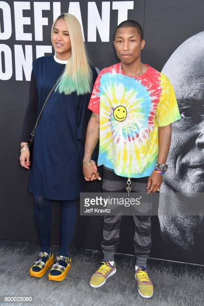 Model Helen Lasichanh and Pharrell Williams attend HBO's 'The Defiant Ones' premiere at Paramount Studios on June 22 2017 in Los Angeles California