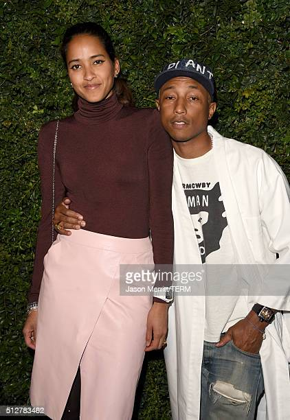 Model Helen Lasichanh and singer Pharrell Williams attend the Charles Finch and Chanel PreOscar Awards Dinner at Madeo Restaurant on February 27 2016...