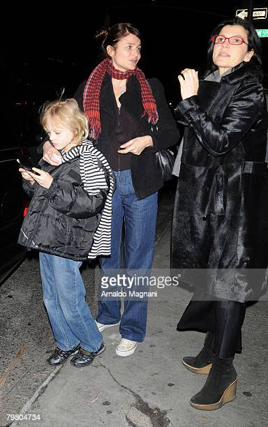 Model Helena Christensen and son Mingus Luchien Reedus stand on the street February 16 2007 in New York City