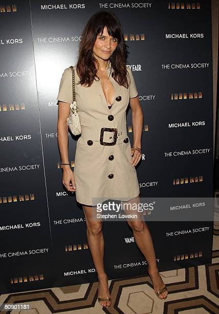 Model Helena Christensen attends a screening of Iron Man hosted by the Cinema Society and Michael Kors at the Tribeca Grand Screening Room on April...