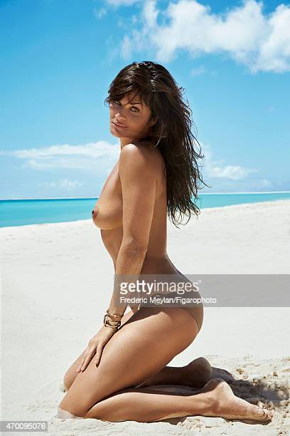 Model Helena Christensen is photographed for Madame Figaro on March 20 2015 in Guadeloupe Saint Martin Beauty by Dior Bathing suit bottom bracelets...