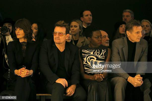 Model Helena Christensen, music artist Bono, author Danai Gurira, actor Liam Neeson attend the front row during the Edun Fall 2016 fashion show...